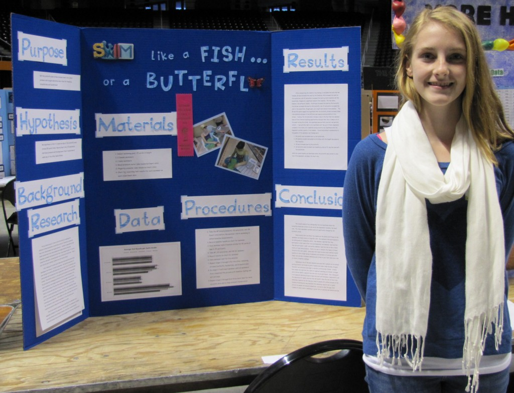 "Kasey Jordan Godwin of Jefferson Middle School and her winning science project, ""Swim Like a Fish or a Butterfly."""