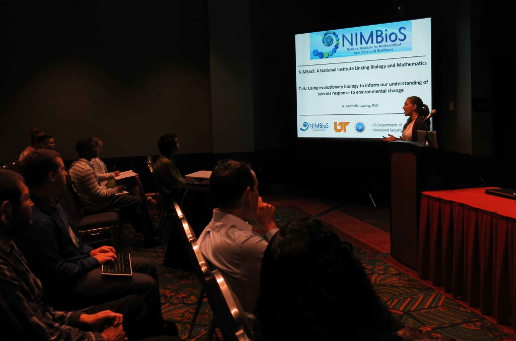 Anna Michelle Lawing, NIMBioS postdoctoral fellow, presents at a symposium at the SACNAS conference.