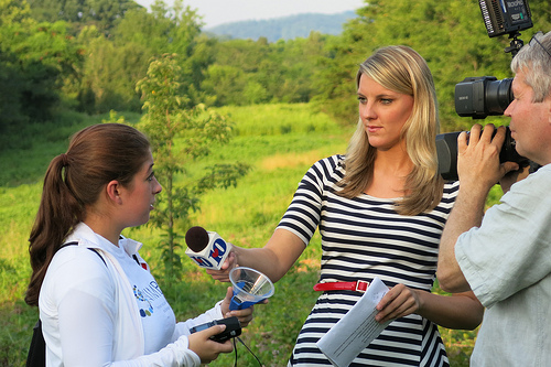 2013 SRE participant is interviewed about her research by the media.