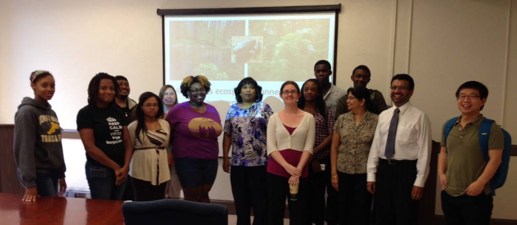 Earl (white sweater, center) poses with FIsk REU students and mentors