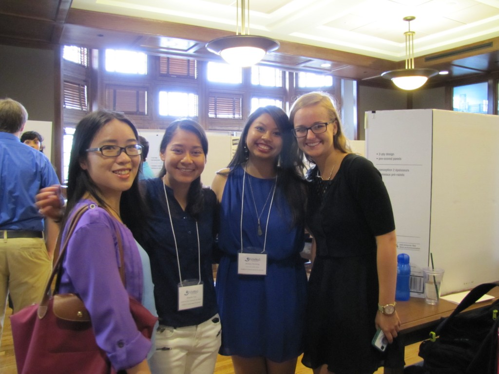 NIMBioS SRE's Fanguyan Hong, Michelle Cruz, Brittany Boribong and Nikki Rooks amid posters at the STEM Symposium